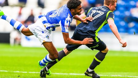 Mikael Mandron goes over in this tussle with James Brown. Picture: STEVE WALLER