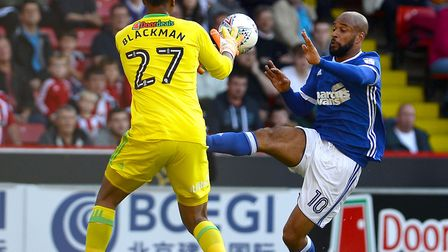 David McGoldrick goes for the ball with Sheffield United keeper Jamal Blackman Picture Pagepix