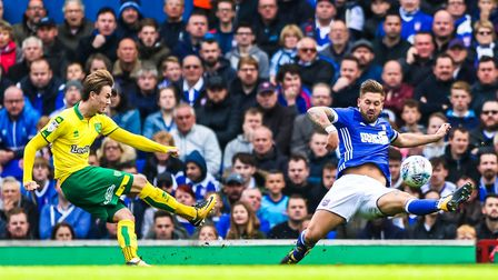 James Maddison fires Norwich into the lead despite the efforts of Luke Chambers to block his shot.