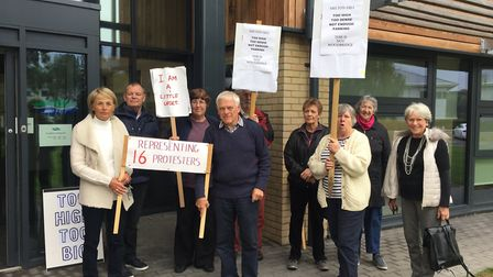 Protesters outside East Suffolk House opposing plans for new homes in Woodbridge: GEMMA MITCHELL