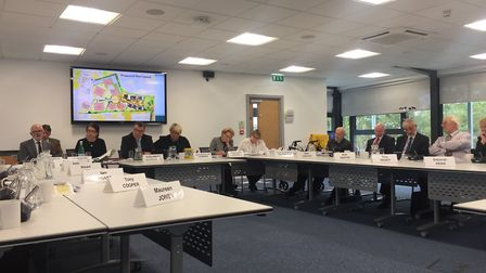 Members of the Suffolk Coastal District Council planning meeting, discussing proposals for the 'chee