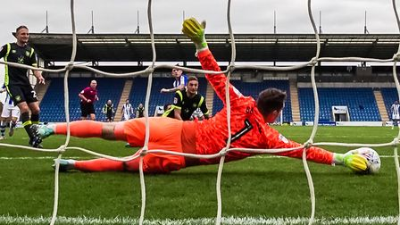 Carlisle keeper Jack Bonham gets a hand to this Sean Murray strike early in the second half of Satur