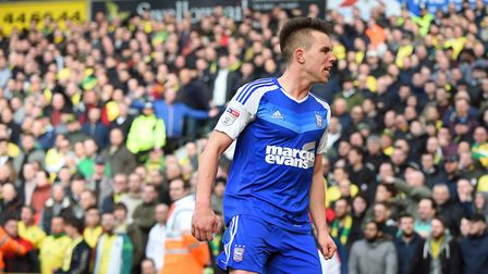 Jonas Knudsen celebrates with the travelling fans after giving Ipswich Town the lead at Carrow Road