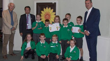 Pupils from Abbots Green Primary School who won a Gold Award with Adrian Bloom, left, Patrick Chung