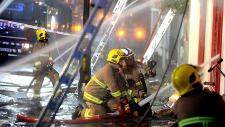 Crews tackle the blaze on Angel Hill. Picture: ANDY ABBOTT