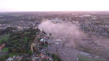 Smoke from the Cycle King fire billows across Bury St Edmunds.Picture: GARY BLUETT