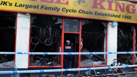 The morning after the serious fire at Cycle King in Bury St Edmunds. Fire investigators at the scen