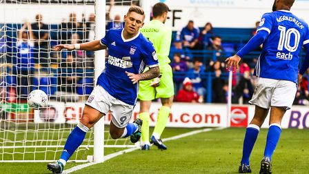 Martyn Waghorn wheels away after scoring for Ipswich Town late in the first half. Photo: Steve Walle