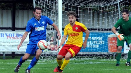Brantham's Sam Newson, left and Walsham defender Lee Warren in action at Summer Road Picture: ANDY