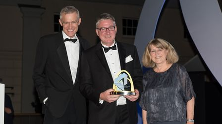 Simon Mullet, company secretary of the Port of Felixstowe, collects the Port Operator of the Year Aw