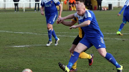 Mark Goldfinch, in blue, has served as caretaker boss for Ipswich Wanderers this season. Mark Benter