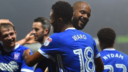 Grant Ward gets a hug from David McGoldrick after scoring Ipswich Town's fifth against Sunderland on