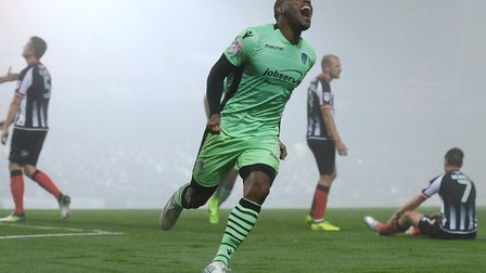 Kyel Reid celebrates scoring his second goal in the 2-2 draw at Grimsby in midweek. Back in 2014, Re