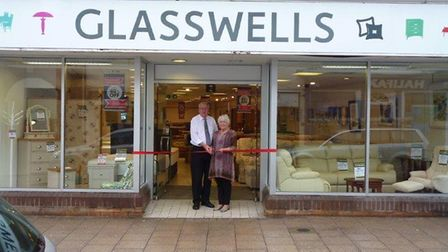 Store managers Peter and Rosemary Woodward cut the ribbon at the Glasswells store on North Street in