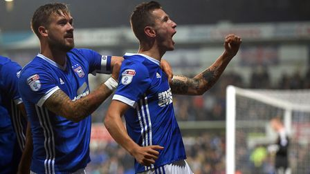 Manchester City loanee Bersant Celina (centre) scored on his full league debut for Ipswich Town in m
