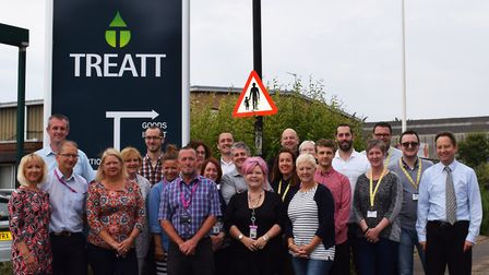 Treatt staff outside the company's premises in Bury St Edmunds, with new look logo and signage unvei