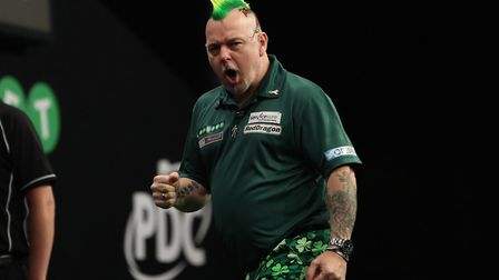 Peter Wright celebrates during his first round win in Dublin. Picture: LAWRENCE LUSTIG