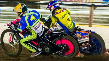 Kyle Newman squeezes round the outside of Josh Bates in the rerun of heat three. PICTURE STEVE WA
