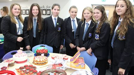 Proud pupils of Thomas Gainsbourgh School with their cakes. Picture: THOMAS GAINSBOURGH SCHOOL