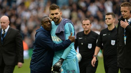 Terry Connor tries to console a disappointed Bartosz Bialkowski after the defeat at Leeds
