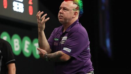 Peter Wright fought through injury to reach the last eight of the World Grand Prix in Dublin. Pictur
