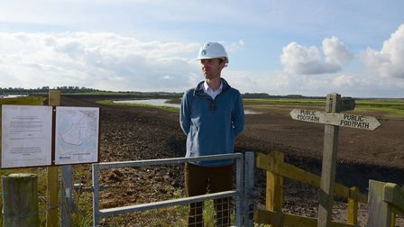 Pete Roberts, operations manager for the East Suffolk Internal Drainage Board, inspects the sea wall