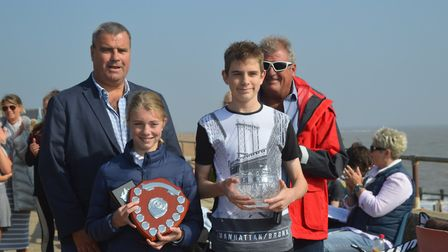 Ben Gray (Ipswich) and Grace Boakes (Deben) receive the Shelia Norman memorial from sons Tim and Jer