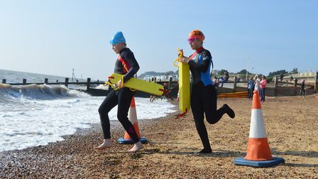 Elsie Price (blue hat) and Ruby Smith (orange hat) in competition at Felixstowe