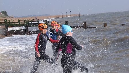From nearest camera: Elsie Price, Helen Jarrett, Ruby Smith and JJ Mee head into the water at Felixs