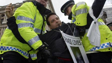 """Mark is removed by police in Whitehall in 2002 during a """"die-in"""" protest. Photo: Chris Young"""