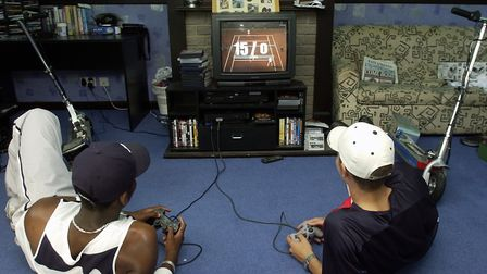 Ipswich Town academy graduates Darren Bent and Darren Ambrose playing a PlayStation game in their di