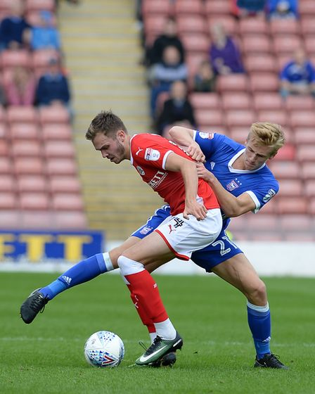 Flynn Downes challenges Barnsley's Joe Williams. The Town teenager, along with Tristan Nydam, has br