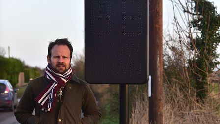 Parish councillor James Mallinder Hollesley speed indicator device (SID). Picture: SARAH LUCY BROWN