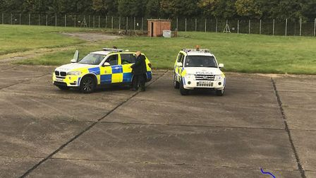 Police officers next to the Ryanair plane. Picture: @zulu_wooloo/PA WIRE