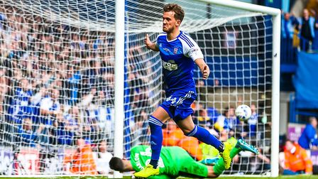 An Achilles injury has prevented midfielder Emyr Huws from playing for Ipswich Town since his loan d