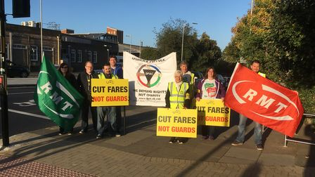 RMT strikers outside Ipswich Station were happy to be pictured - but had been told by their union le