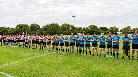 West Norfolk and Woodbridge hold a minute's applause in memory of Josh Gilbert. Picture: SIMON BALLA