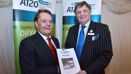 John Hayes, roads minister, presented with a petition from businesses calling for improvements to th