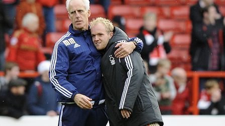 Mick McCarthy gives Jonny Williams a hug during the latter's loan spell at Nottingham Forest. Photo: