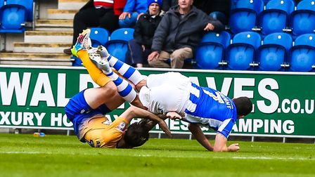 Drey Wright is stopped in his tracks by Mansfield right-back Paul Anderson during the U's 2-0 win on