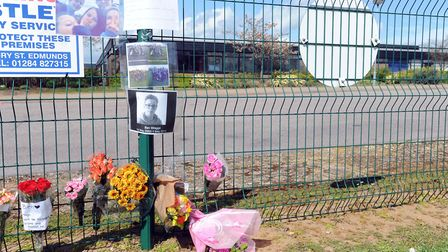 Floral tributes left outside Thurston Community College following the tragic death of Ben Wragge las
