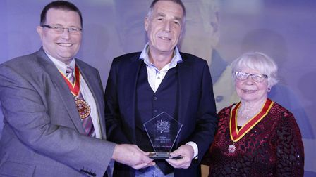 PCSO John Hood, centre, receiving the Police Person of the Year award last year from former chairman
