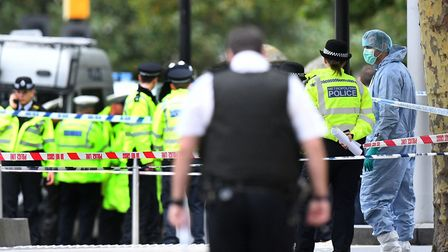 Police at the scene on Cromwell Gardens in London, after several people have been injured after a ca