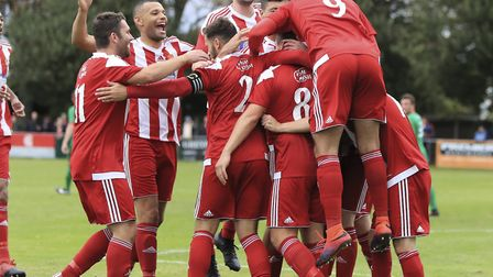 Stuart Boardley is mobbed by team-mates after he put Felixstowe & Walton United in front against Ely