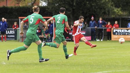 Stuart Ainsley breaks clear to add to his goal tally in Fleixstowe & Walton United's victory against