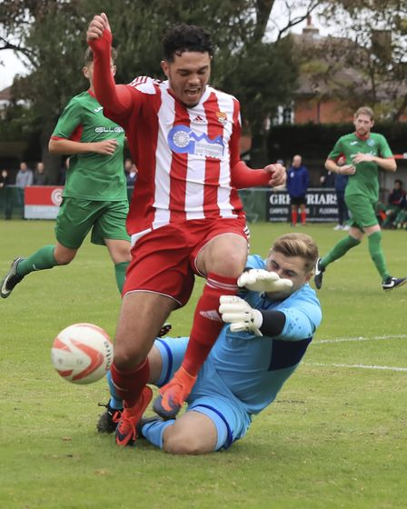 Felixstowe & Walton United were awarded a penalty after Nick Ingram was pulled down by Ely City's Ha