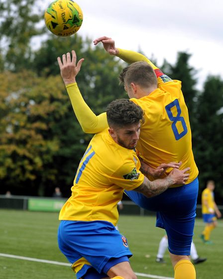 AFC Sudbury duo Jake Clowsley and Sam Clarke rise for the same ball. Picture: ANDY ABBOTT