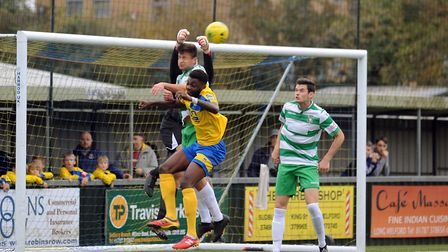 Aylesbury goalkeeper Jack Sillitoe clears from AFC Sudbury's Julian Smith. Picture: ANDY ABBOTT
