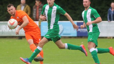 Diss Town captain Jack Tipple plays a through ball. Picture: Gary Donnison