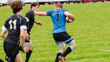 Tom Stokes stiff-arms a would-be Holt tackler. Picture: SIMON BALLARD